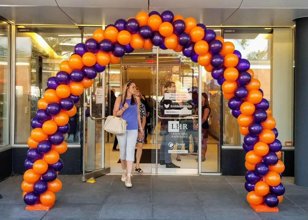 orange and purple balloon arch for grand opening in Manhattan