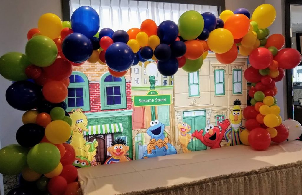 colorful balloons candy table arch for sesame street theme